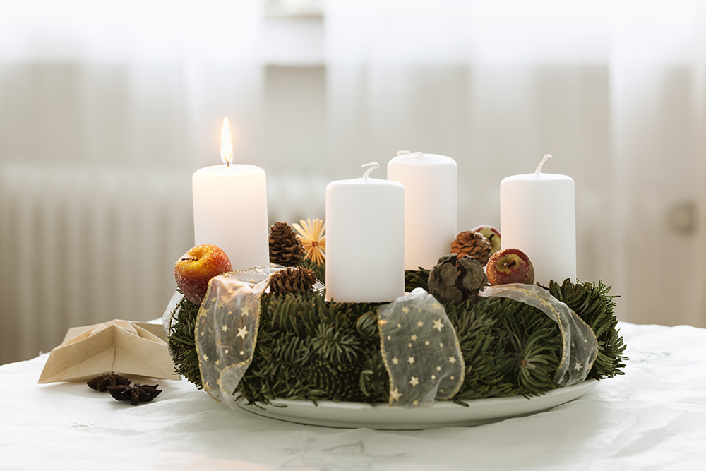 advent wreath burning candle at cristmas time